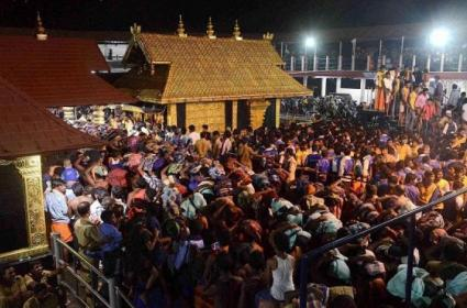 SC Says Denying Entry To Women In Sabarimala Temple Is Against The Constitution - Sakshi