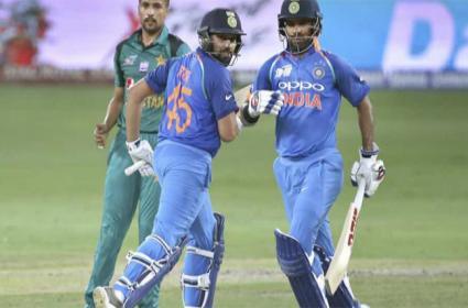 Records tumble after Rohit Sharma and Shikhar Dhawans stunning partnership - Sakshi