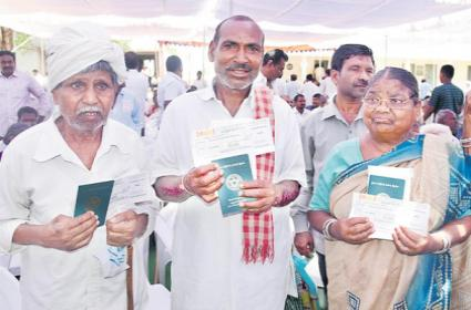distribution of checks in front of officials - Sakshi