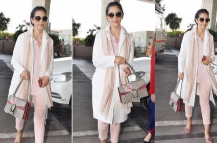 Manisha Koirala Pairs Costly Bag At The Airport - Sakshi