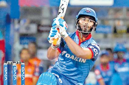 Mumbai Indians condemned to defeat after Rishabh Pant heroics - Sakshi