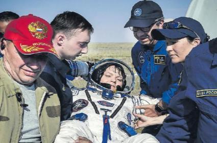 Soyuz Capsule Returns Station Crew to Earth After 204 Days in Space - Sakshi
