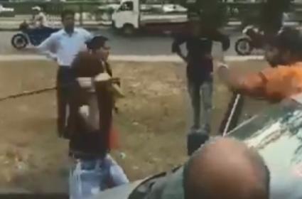 A girl attacks a man with a rod near Tribune Chowk - Sakshi