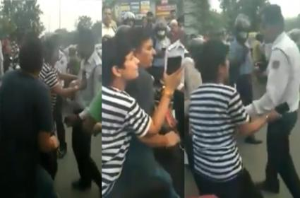 Woman and Man Misbehaved With Traffic Police - Sakshi
