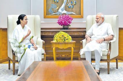 Mamata Banerjee Meets PM Narendra Modi in New Delhi - Sakshi