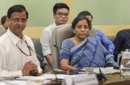 GST Council May Cut Tax Rates - Sakshi
