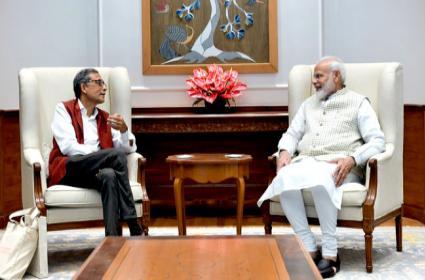 Nobel Prize winner Abhijit Banerjee Meets Modi - Sakshi