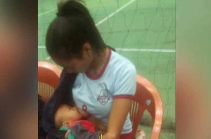 Mizoram Volleyball Player Breastfeeds 7 Months Child In Break Wins Internet - Sakshi