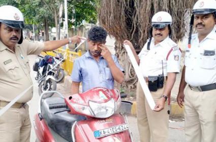 71 Challans on Scooty in Karnataka - Sakshi