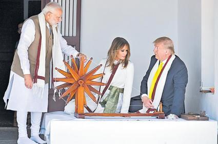 Donald Trump visit Sabarmati Ashram, try hands on charkha - Sakshi