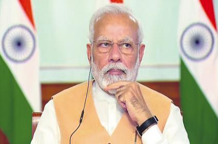 PM Narendra Modi reviews COVID-19 situation in India - Sakshi