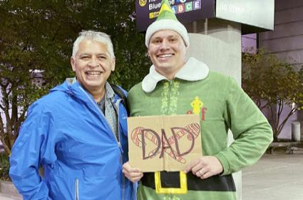 Son Meets Father In ELF Costume For The First Time In Boston - Sakshi