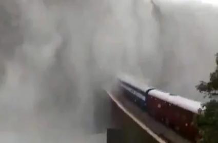 Dudhsagar: Train Passing Through Goa Waterfall In Heavy Rain Viral - Sakshi
