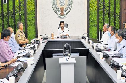 CM YS Jagan with collectors SPs JCs and superiors in Spandana Program - Sakshi