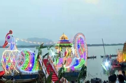 Sri Durga Malleswara Swamy Teppotsavam In Krishna River - Sakshi