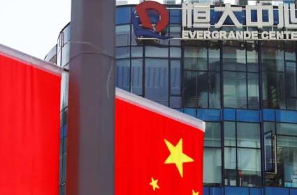 China Evergrande Shares Sharp Fall default risks spook global markets - Sakshi