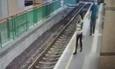 Man pushes woman on rail track