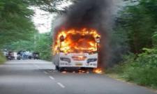 Private Bus Catches Fire in vizianagaram district - Sakshi