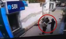 Gun fire at Delhis Majra Dabas SBI ATM - Sakshi