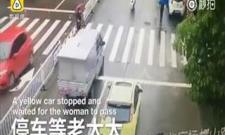 Car Blocks Traffic So Elderly Woman Can Cross Road. - Sakshi