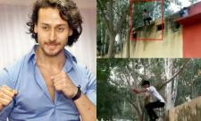 tiger shroff fan jumping of ai 13 feet wall in mumbai - Sakshi