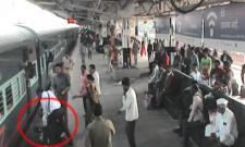 tte saves passenger from falling under moving train - Sakshi