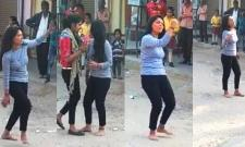 Girl dumped by lover dances to Bollywood song outside his house - Sakshi