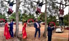 Photographer Hangs From Tree To Click Pics - Sakshi