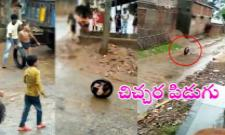 Boy Rolls Around The Street In A Tyre video goes viral in Social Media - Sakshi