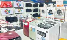 GST on refrigerators, washing machine reduced to 18 percent - Sakshi