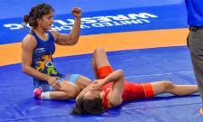 Vinesh Phogat Cretes History With Wrestling Gold Medal - Sakshi