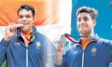 Asian Games 2018: Shooter Deepak Kumar and lakshay wins air rifle silver - Sakshi