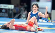 Wrestler Vinesh Phogat wins gold in Asian Games - Sakshi