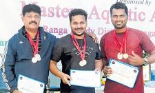 Ravi, Surendra got Gold Medals in Telangana Masters Swimming Championship - Sakshi