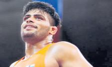 Indian boxer win a silver medal - Sakshi