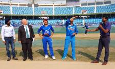 MS Dhoni walks out for the toss against Afghanistan Match - Sakshi