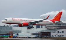 Air India flight attendant falls off plane at Mumbai airport - Sakshi