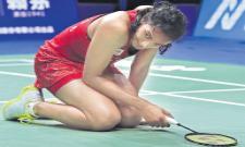 Sindhu knocked out in first round - Sakshi