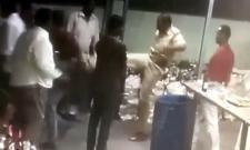Anantapur One Town CI Vijaya Bhaskar Beats Drinkers In Anantapur - Sakshi