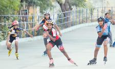 Arnavi, Vedanth Win Skating Titles - Sakshi