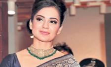 Kangana Ranaut looks striking in this royal blue traditional sari - Sakshi