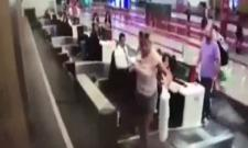 First Time Flyer Steps on Conveyor Belt With Luggage