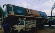 Volvo Bus From Vizag To Bangalore Fell On TATA ACE At Renigunta - Sakshi