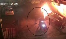 Vehicles Set on Fire By Miscreants in Vijayawada - Sakshi