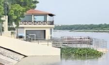 Chandrababu house is safe with flood control - Sakshi