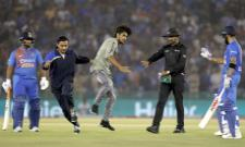 A Fan Embarrassed Kohli in the Mohali Stadium - Sakshi