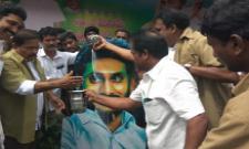 Janasena MLA Abhishekam To CM YS JAgan Flexy With Milk - Sakshi