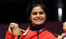 Manu Bhaker Bags Gold And Breaks Junior World Record - Sakshi