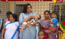 RK Roja Gives Polio Drops To A Child In Camp Office - Sakshi