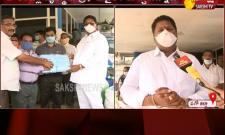 Karumuri Nageswar Rao Distributes Masks And Sanitizers In Tanuku